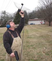 Kenny Atkison using parabolic ultrasonic microphone to locate arcing